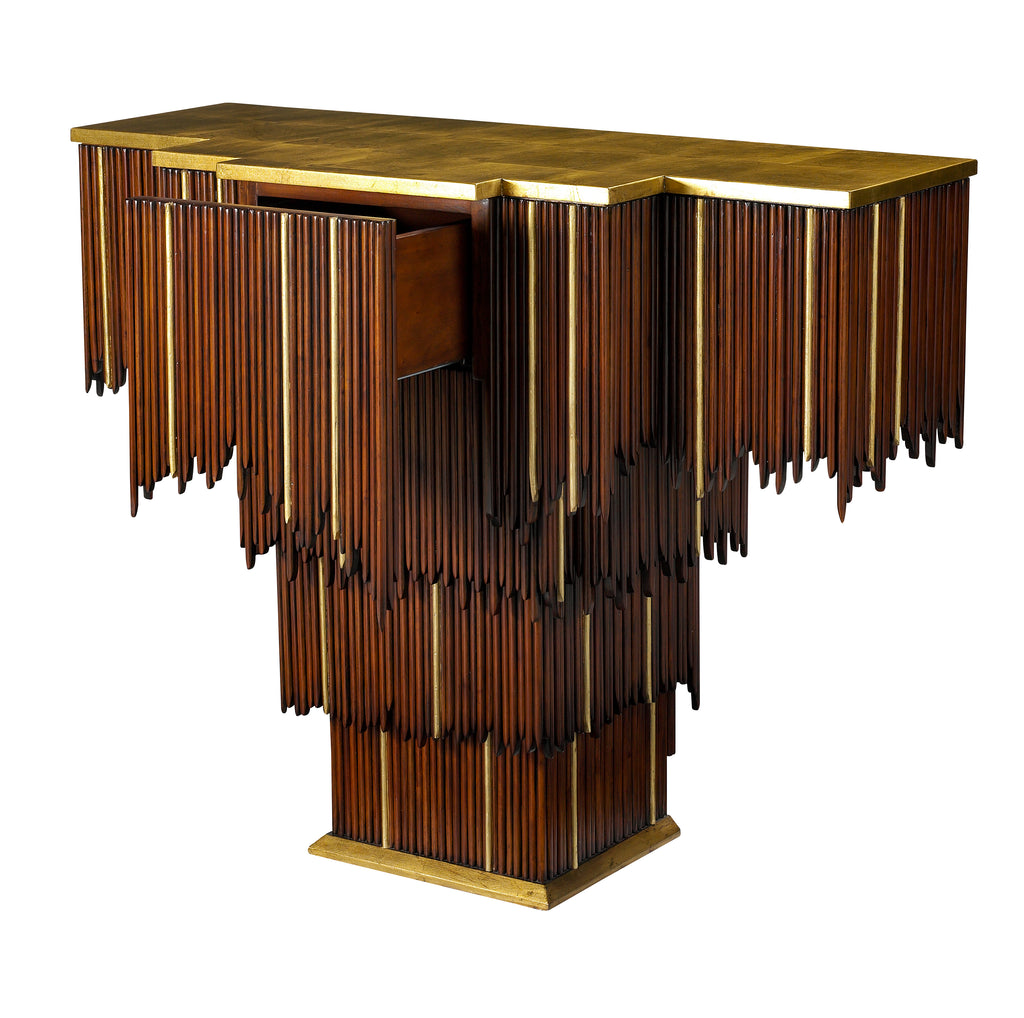 The Mai Tai Entry Table features a cascading form of mahogany and gold trim, as well as a gold leaf top and base. This piece from The Facet Collection was designed by Michelle Workman for French Heritage and is perfect for anyone looking to achieve that luxurious, high-end look in their home. Drawer detail of the extended top and base option is shown here.