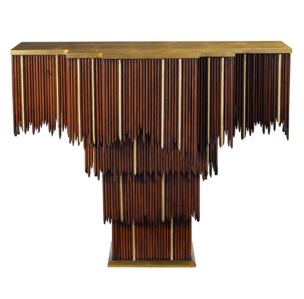 The Mai Tai Entry Table features a cascading form of mahogany and gold trim, as well as a gold leaf top and base. This piece from The Facet Collection was designed by Michelle Workman for French Heritage and is perfect for anyone looking to achieve that luxurious, high-end look in their home. The extended top and base option is shown here.