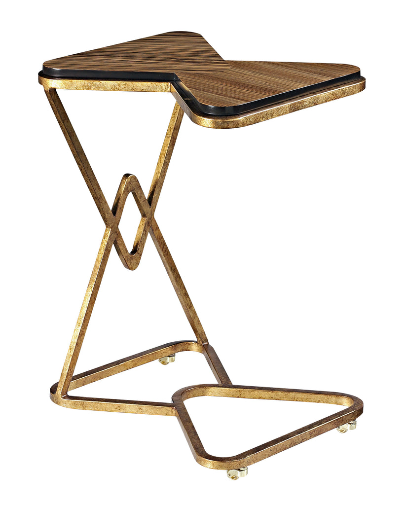 The Black Russian Computer Table from The Facet Collection: designed by Michelle Workman for French Heritage. This Zebrawood and gold-leafed iron piece is a perfect little pull-up table for any multi-tasker who wants to maintain a luxurious look in their space.