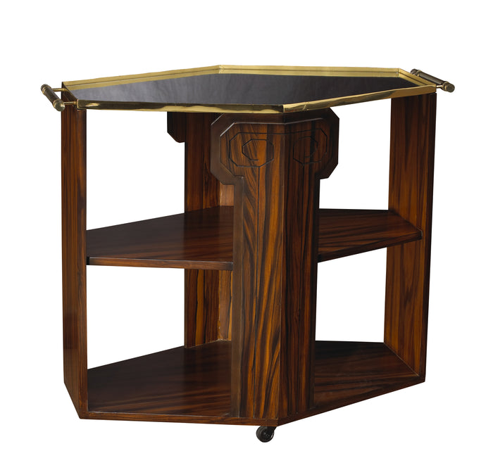The Cuba Libre Bar Cart in Mahogany and Rosewood detail dazzles with its mirror and brass tray top, plexiglass handles, and solid brass caster. This piece from The Facet Collection was designed by Michelle Workman for French Heritage and is perfect for anyone looking to achieve that luxurious, high-end look in their home.