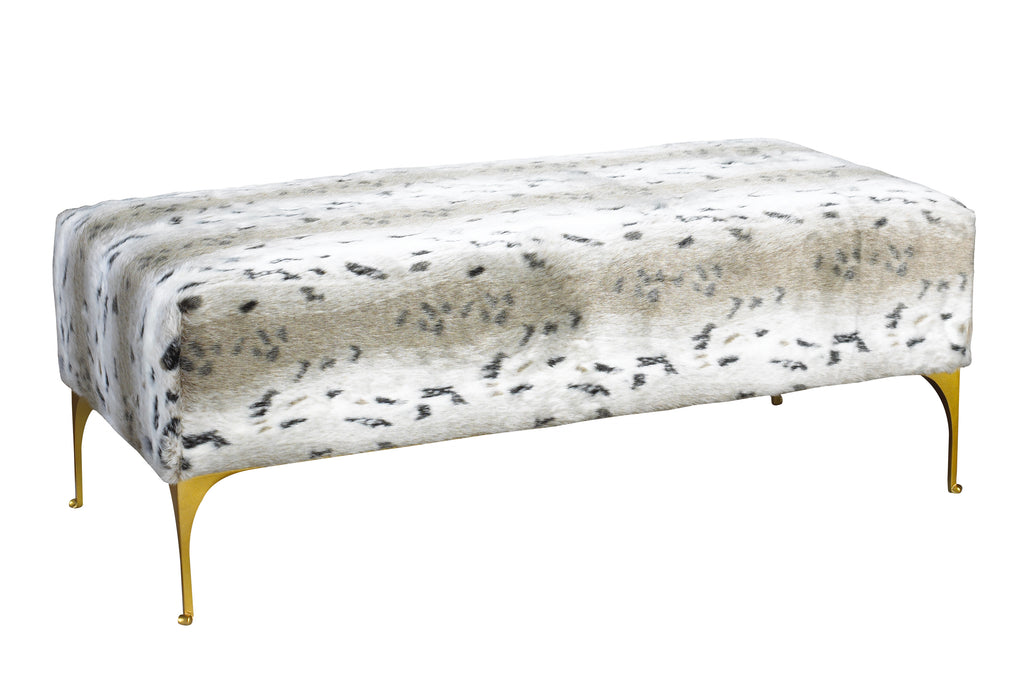 "As seen in the 2017 Traditional Home Dallas Showhouse, the Manhattan Bench brings the ""big city glam"" into your home. Delicate metal legs and frame highlight this ever versatile piece, which is available to be covered in a customer's own fabric. This piece from The Facet Collection was designed by Michelle Workman for French Heritage and is perfect for anyone looking to achieve that luxurious, high-end look in their home. Shown here in the faux Snow Lynx fabric."
