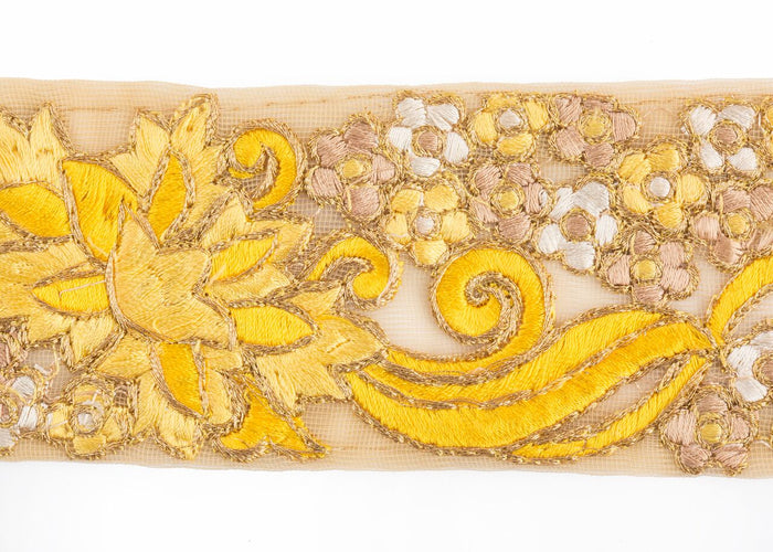 "This stunning lemon-yellow, gold, and white floral trim is 2.25"" wide and is sold by the yard for use on curtains, upholstery and home accessories. Perfect for the individual looking to achieve that luxurious, high-end look in their home, this trim by Michelle Workman for Pyar&Co. adapts perfectly to any room."