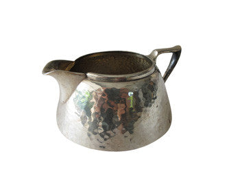 An antique set of Forbes Silver Co. silver-plated, hammered finish sugar bowl and creamer circa 1895. Creamer shown here.