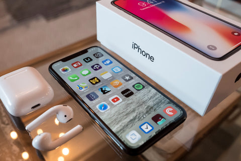 iPhone X with Airpods and iPhone box
