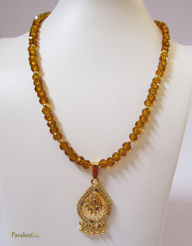 Fashion Jewellery: Gold Plated Pendant and Facet Crystals Necklace