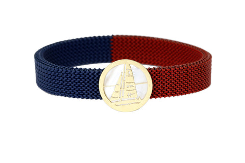 An 18 carat gold 'Anchor' centerpiece with a red & blue stretchable, stainless steel band. - The Ethnic Fix - Dubai - UAE