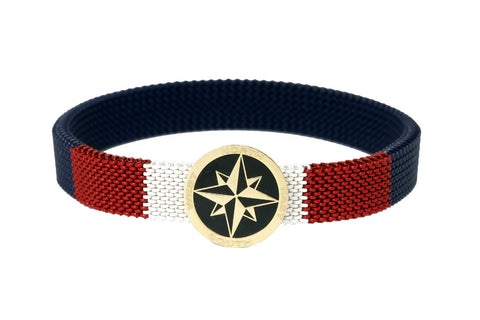 An 18 carat gold 'Compass' centerpiece with a red, blue & white stretchable, stainless steel band. - The Ethnic Fix - Dubai - UAE