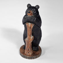 Black Bear Hugging A Log Statue