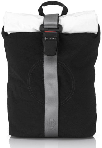 product picture of a black Airpaq from the front. Black main body with a white rolltop