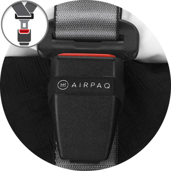 A round cut image of a close-up from a car buckle that is used as closing mechanism for a black Airpaq. On the left corner is an icon that symbolizes buckles