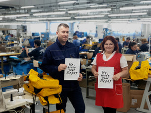 Romanian seamstresses in factory with sustainable backpacks