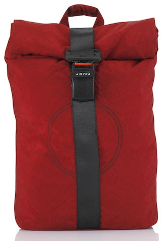 product picture of a red Airpaq from the front. Red main body with a white rolltop