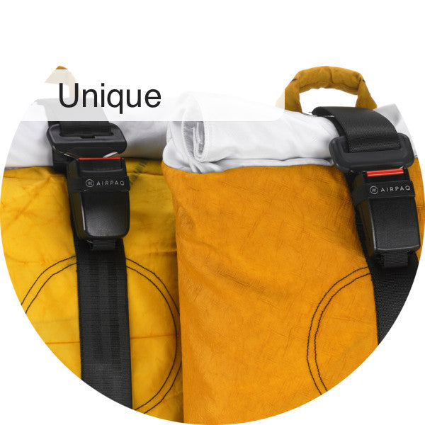 Two yellow Airpaqs with individual look due to different color intensity, textile pattern, buckle and seat belt pattern.
