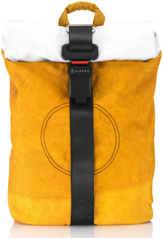 product picture of a yellow Airpaq from the front. Yellow main body with a white rolltop