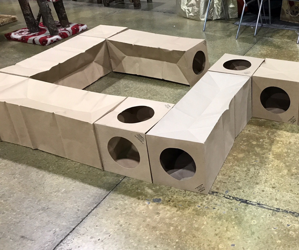 a series of Hide and Sneak paper cat tunnels linked together to form a cat sized hobby trail
