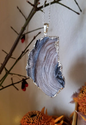 Blue grey and tan natural druzy chalcedony pendant with silver plated edge and chain
