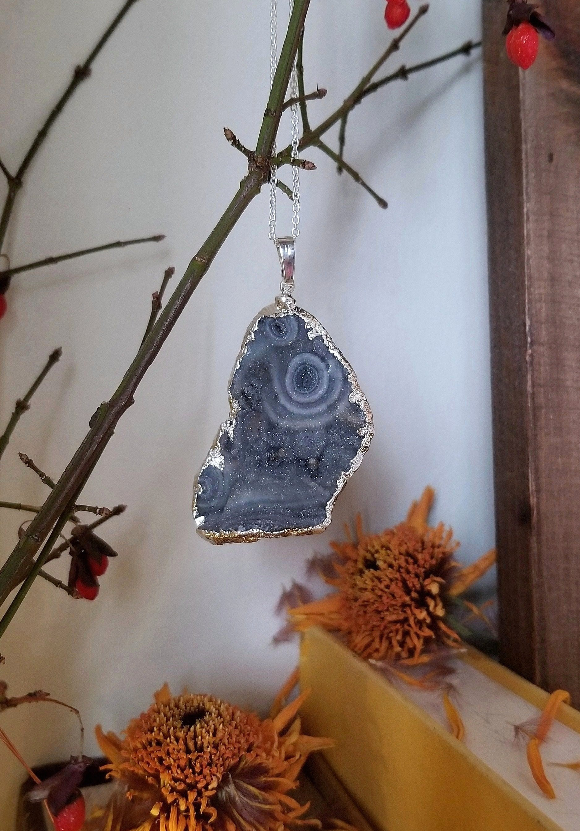Grey/blue chalcedony druzy pendant with silver edge