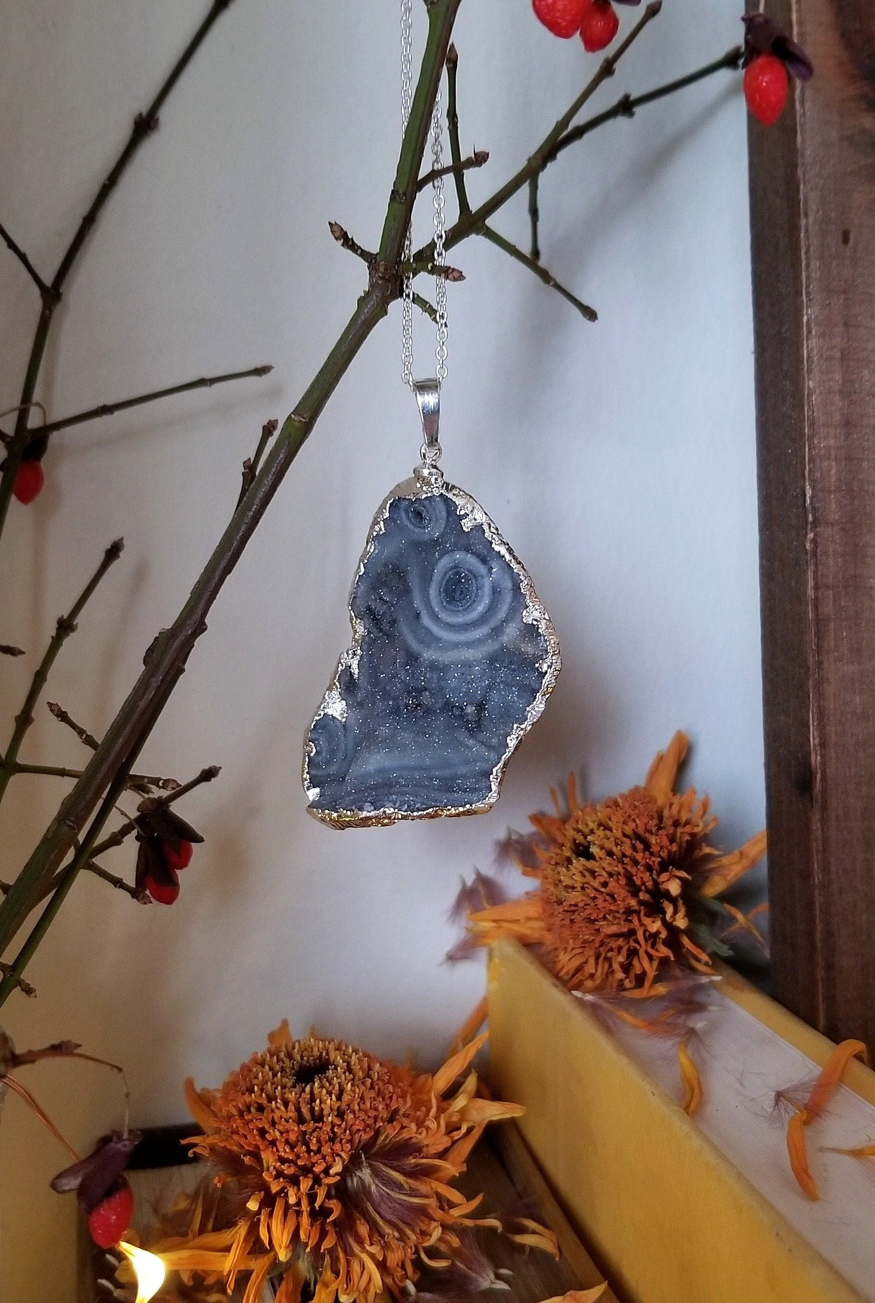 Grey/blue chalcedony druzy pendant with silver plated edge and chain