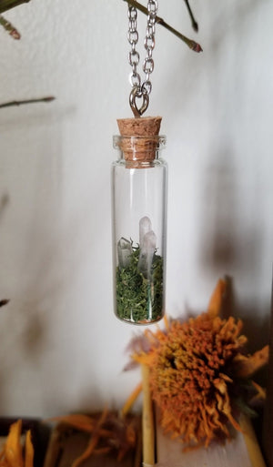 Glass vial necklace with green moss and three mini clear quartz points