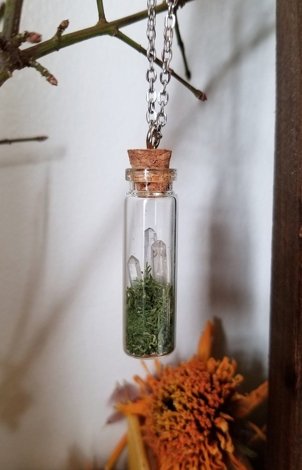 Glass vial pendant with green moss and three mini clear quartz crystals