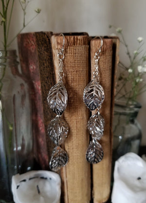Leaf trio dangle earrings filled with glass crystals and sterling silver chain and ear wires