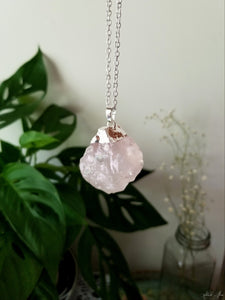 Raw rose quartz pendant with silver plated top and 24 inch silver plated chain