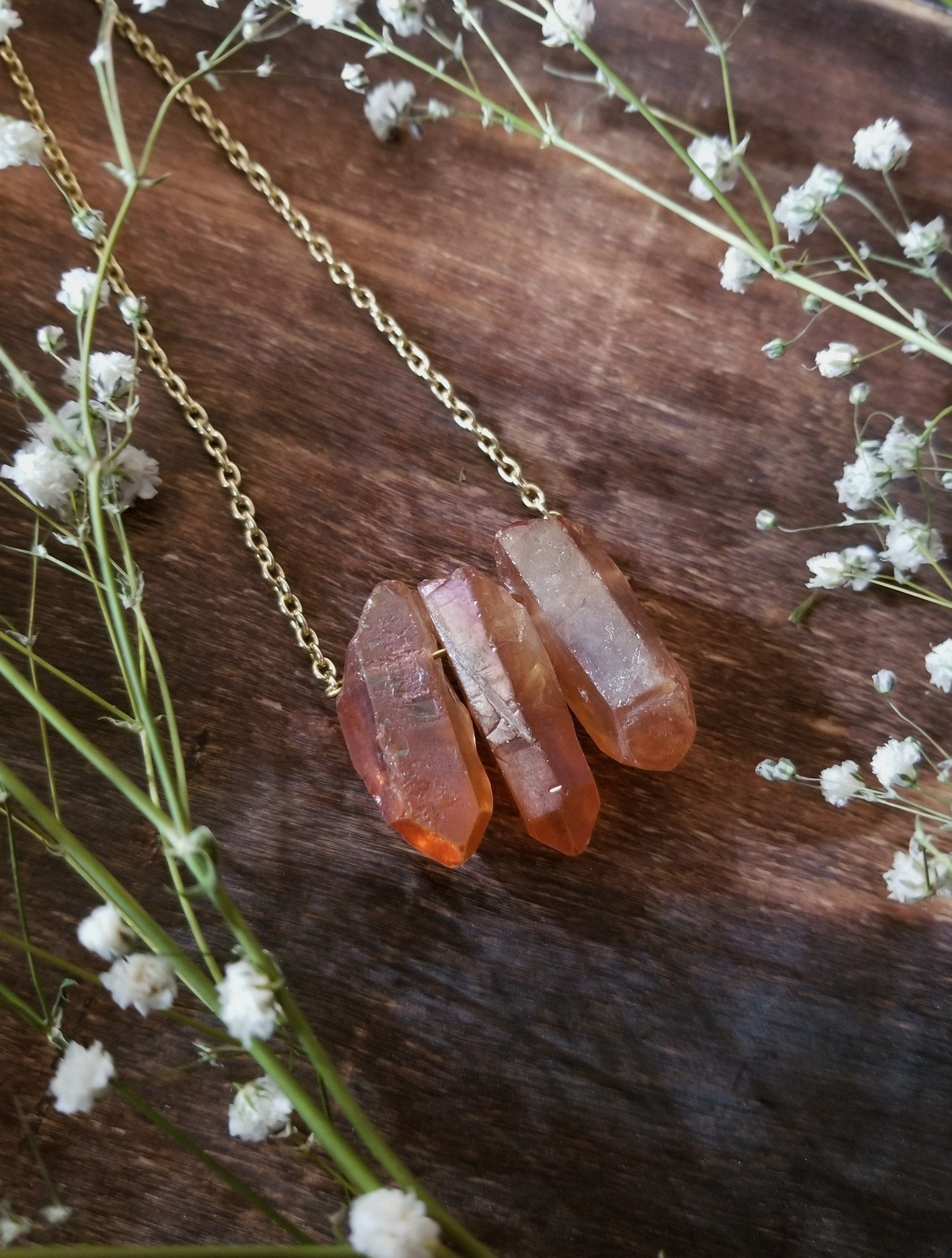 Three tangerine aura quartz points on a yellow gold plated 18 inch chain