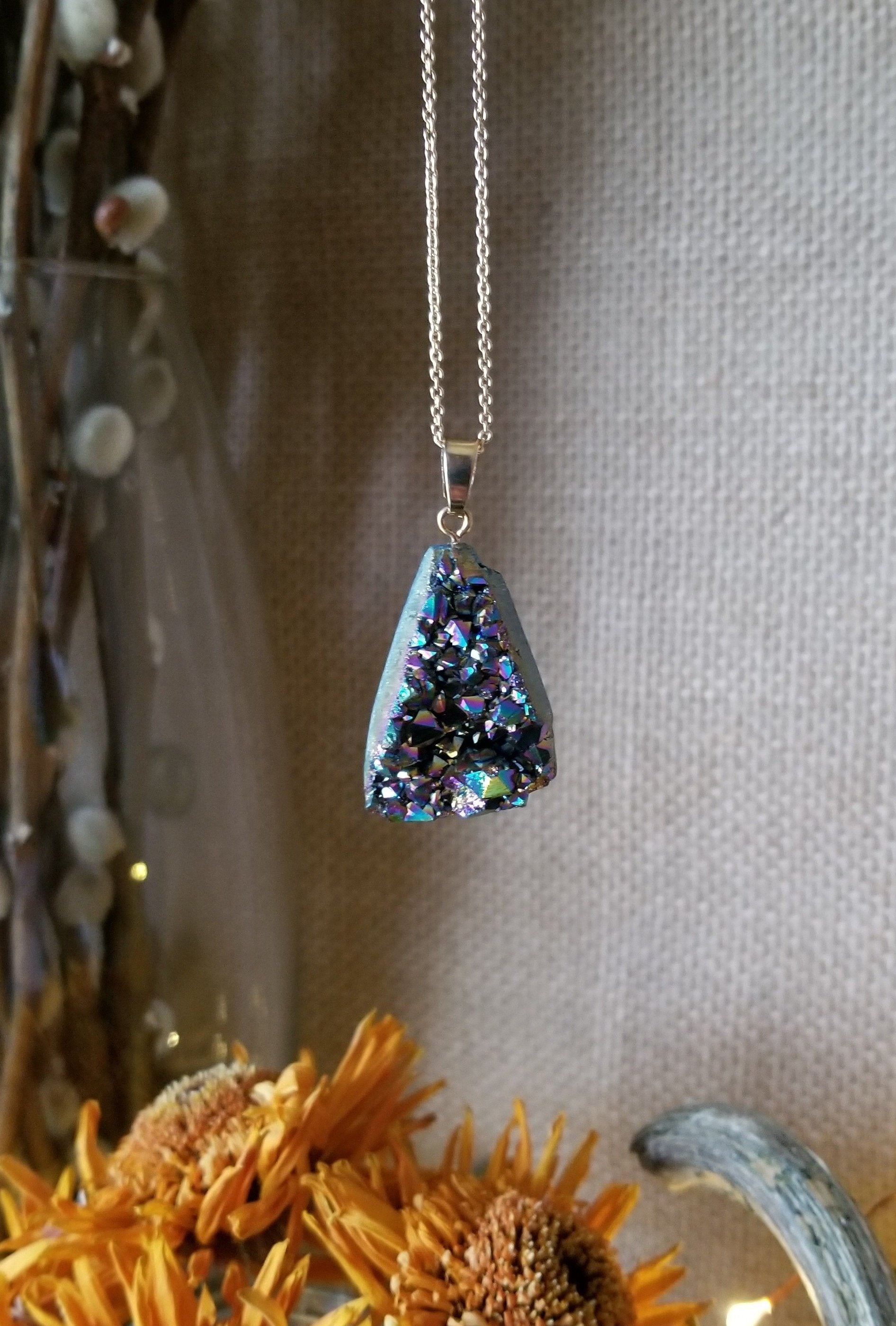 Triangular titanium aura quartz pendant with adjustable gold plated chain