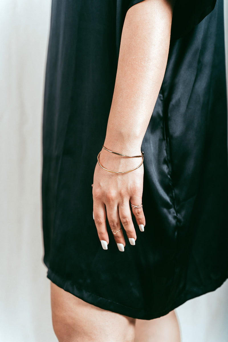 Our Model wearing the gold hex stacking bangles