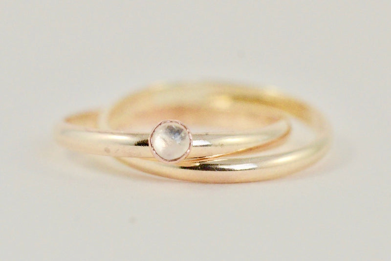 Our gold orbit meditation ring with gemstone
