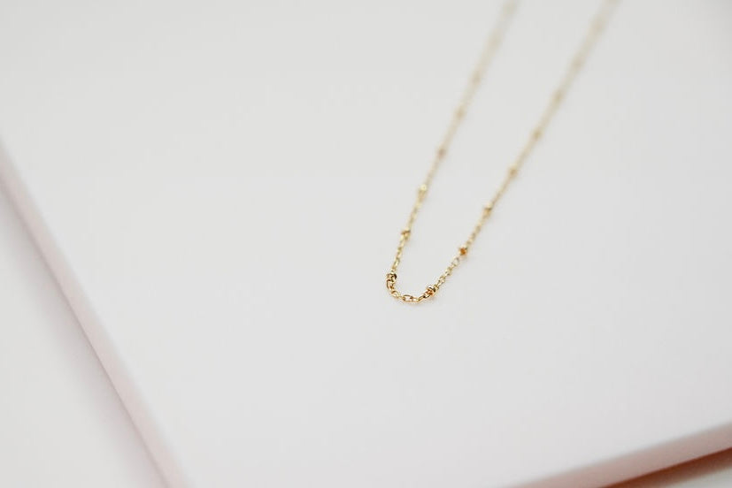 gold choker ball necklace