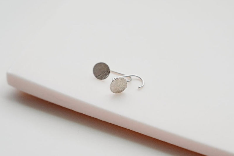 Our silver j-hook earrings showing the brushed texture