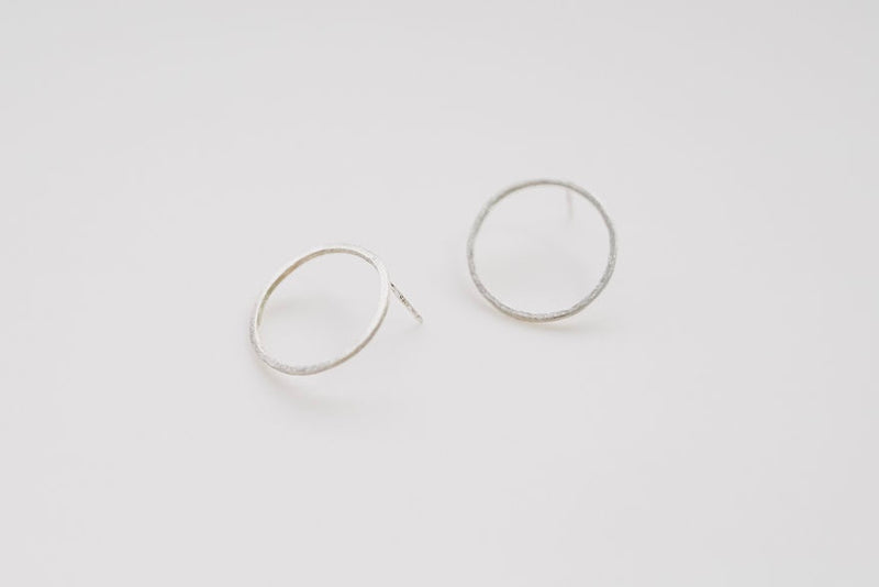 Our pair of black moon silver earrings, a large open circle look