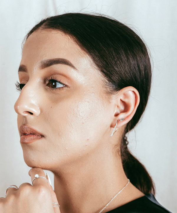 Our model wearing the silver branch studs