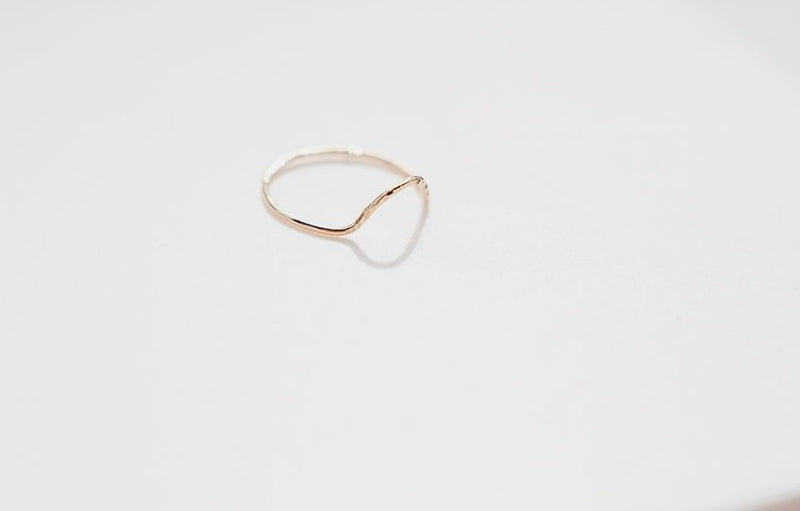 A side angle of the gold cleopatra stacking ring