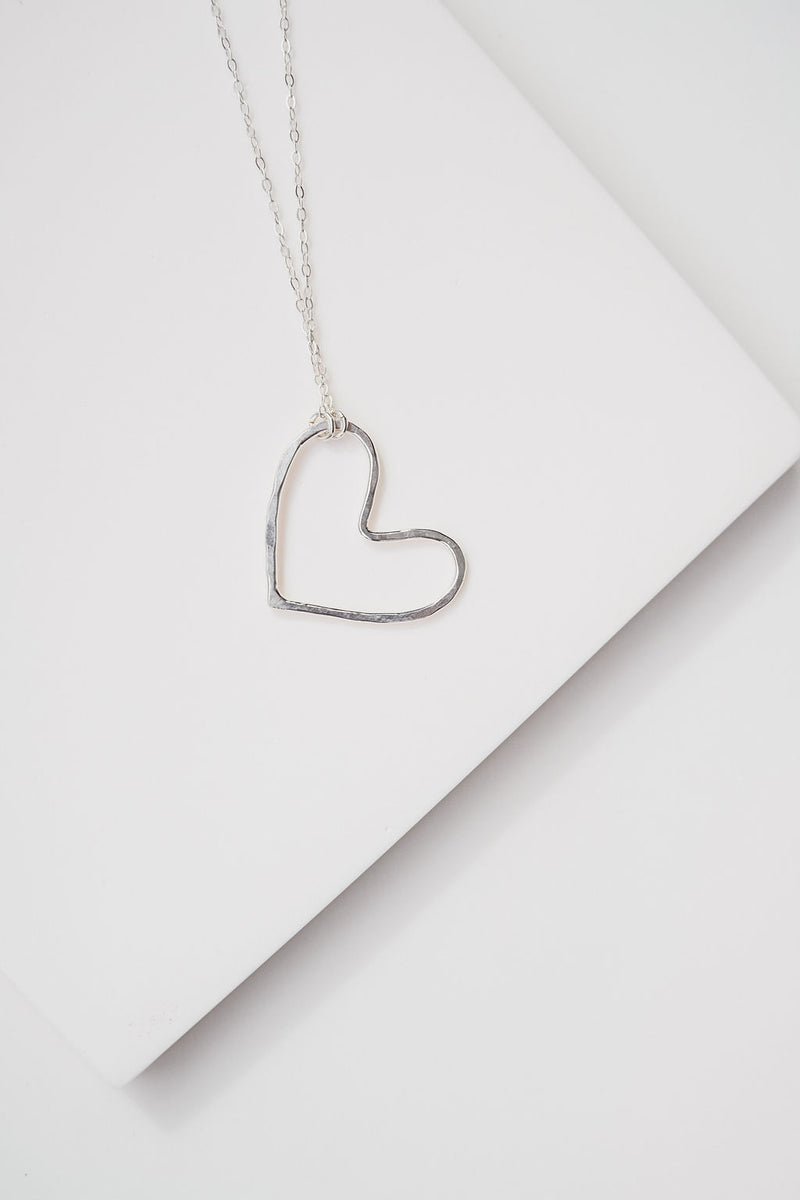 The silver heart necklace