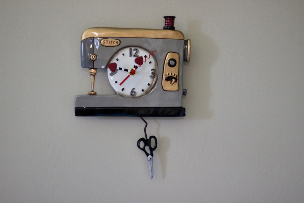 Back Stitch Sewing Machine Pendulum Clock, Gray