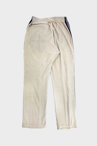 needles velour narrow track pant in beige full image of the front of the pants
