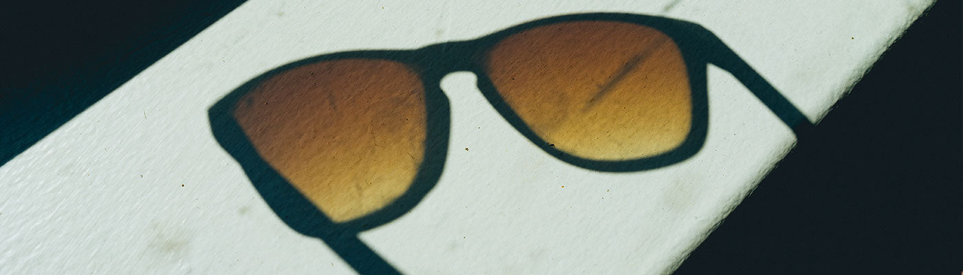 Reflection of a pair of sunglasses with orange lenses