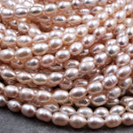 "Genuine Freshwater Natural Pink Peach Pearl Oval Rice Shape 8mm Iridescent High Luster Pearl 16"" Strand"