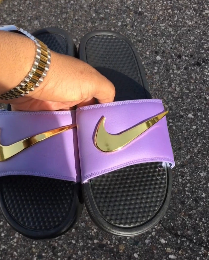 purple and gold nike slides