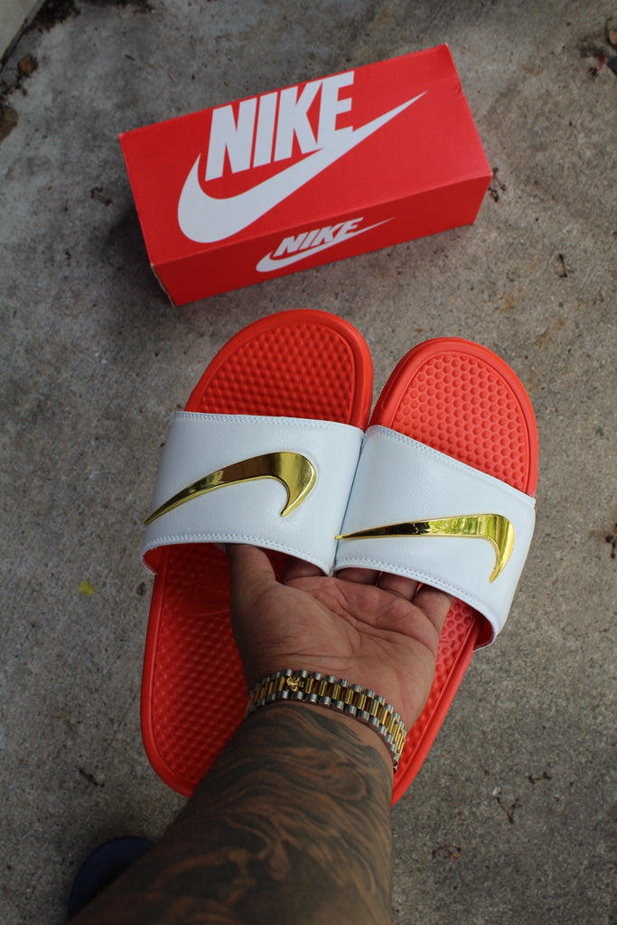 red nike slides with gold check