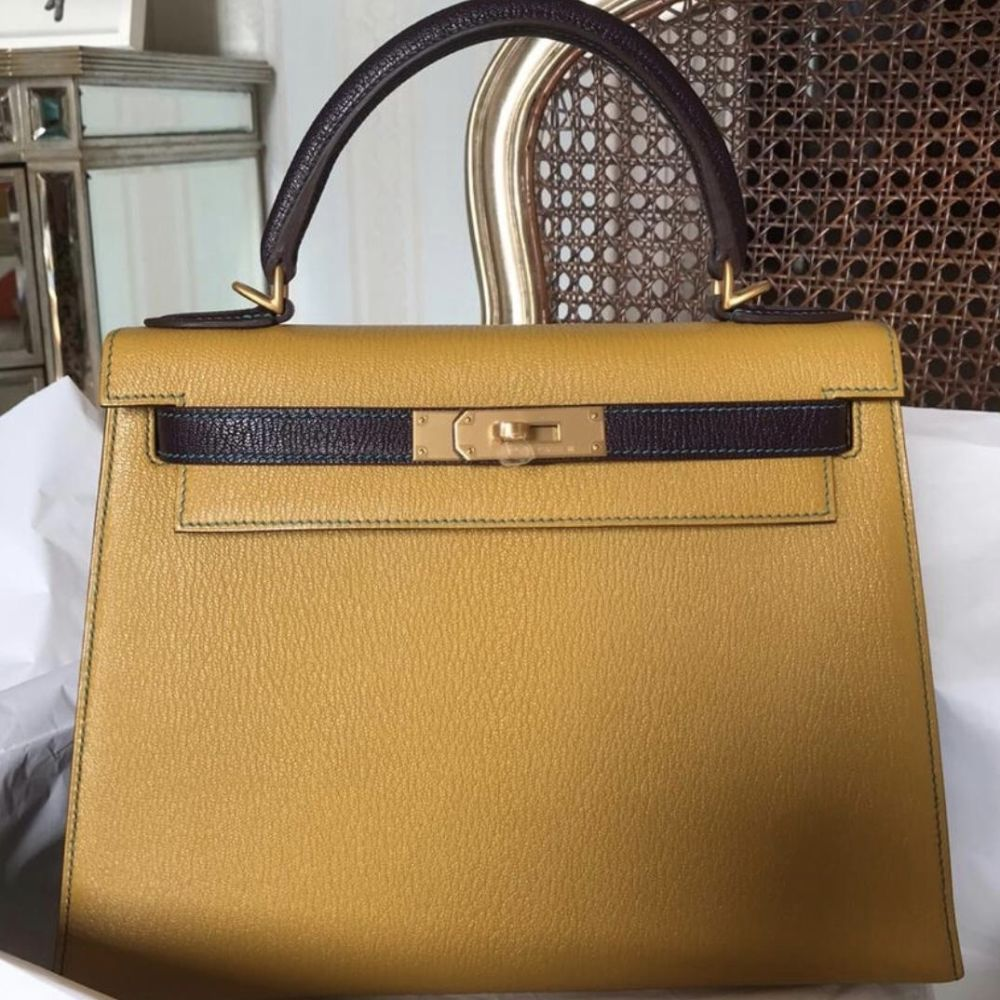 Hermès Kelly 28 Jaune Ambre/Prunoir Sellier Chevre Mysore Brushed Gold Hardware BGHW