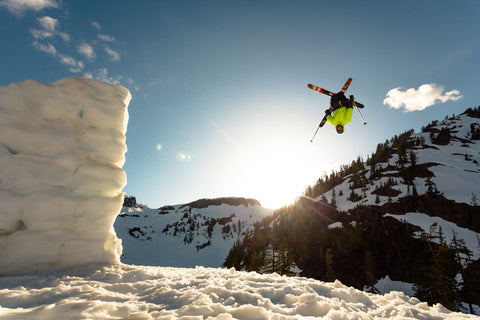Taylor James backflipping a ski jump.