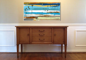 Coastal Seascape by Steve Adam presented over cabinet