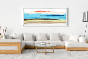 Seascape painting above living room couch