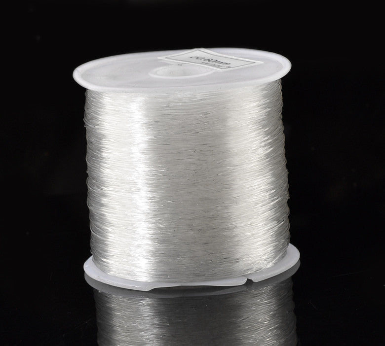 DoreenBeads Lovely 1 Roll(90M) Clear Nylon Beading Stretch Cord 0.6mm  (B21703)
