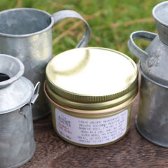 Jar of balm with mini milk cans