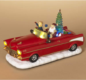 10-Inch Lighted Santa Driving Vintage Red Convertible Car Figurine with Rotating Christmas Tree – Animated Light-Up Holiday Decoration – Tabletop Winter Animatronic Decor