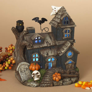 LED Lighted Halloween Village Haunted House with Skull, Pumpkins, and Ghost - Tabletop Halloween Decoration